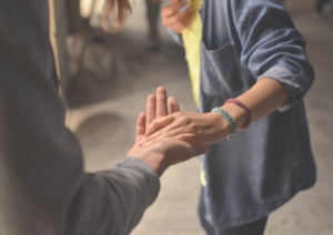 hands reaching out to offer helping hand, care for caregiver